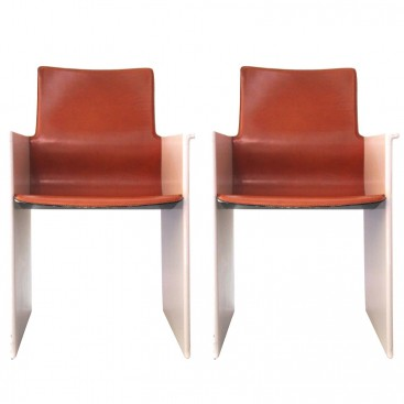 Pair of armchairs, Leather and pink lacquer Circa 1970, France.